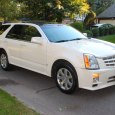 "Longitudinally mounted V6, rear wheel drive-based AWD system, double-wishbone front suspension, car-based unibody platform, strut tower brace, huge ""Ultraview"" moonroof, seven-passenger seating, and luxury touches everywhere.  The first-generation Cadillac SRX […]"