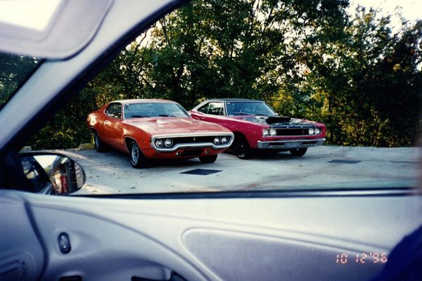 2 cadillacs and 2 plymouths