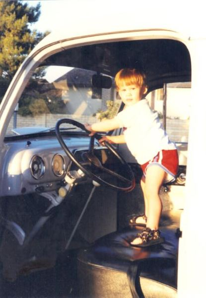 My son enjoying that cab. Note the much later added turn signals.