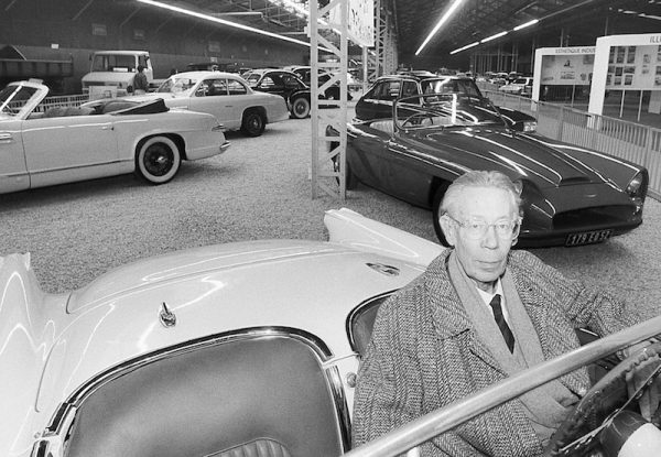 Our man many years later, in his museum, sitting in a 1953 Corvette.