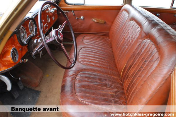 The car's tapered shape dictated a narrower rear seat, but a usable three-passenger front bench seat.