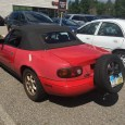 OK, I've not seen this one before. Judging by the roll cage and shaved tires, this person clearly uses their Miata for actual autocrossing events.