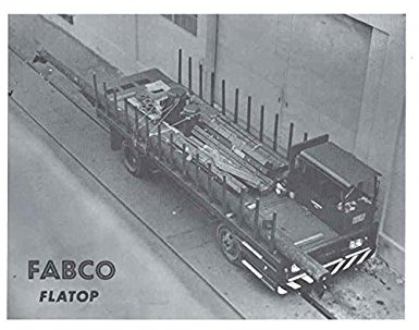 Fabco Flat Top Truck. The cab is to the sid so that pipe can extend all along the deck, even in front of the cab