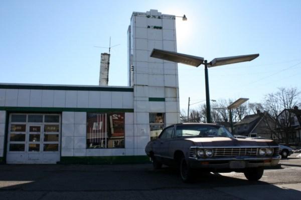1967 Chevrolet Impala hardtop sedan in front of Severance Service / former Hi-Speed gas station.