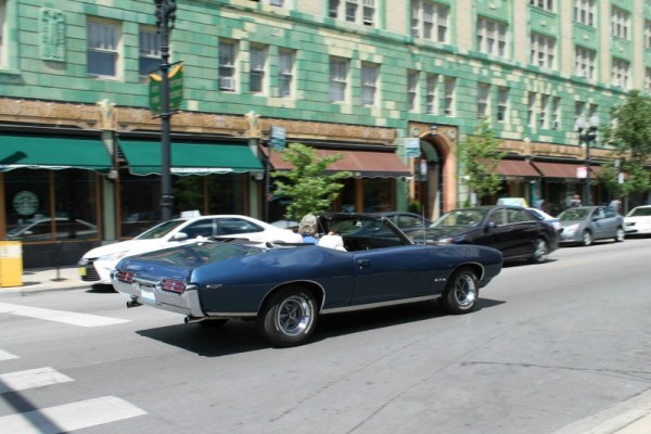 1969 Pontiac GTO convertible in Edgewater, Chicago, Illinois. Frame 4 of 4.