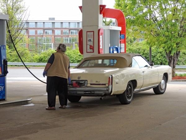 1976 Cadillac Eldorado at gas station