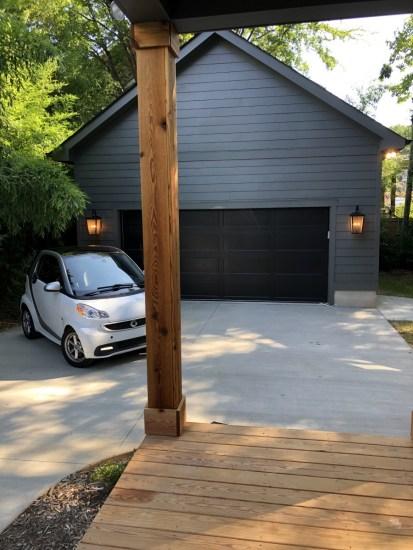 smart car behind a house