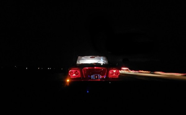 Night towing. Studebaker all lit up.