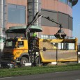 A heavy-duty truck with its own crane and a hooklift system, carrying an open top container with a dropside on the left. This 2020 Volvo FMX must be the trucking […]