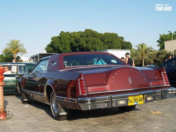 Maroon Lincoln Continental Mark V
