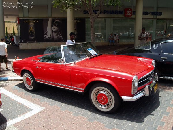 red Mercedes-Benz W113