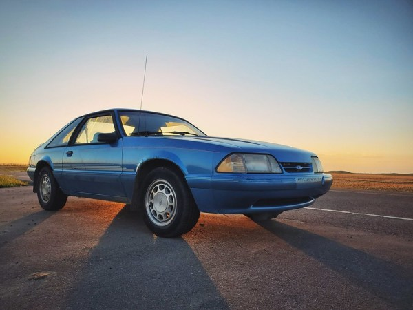 1992 Ford Mustang with sunset.