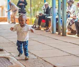 Our lively friend showing everyone how fast she can run, during a mobile clinic in June 2016, 10 months after her surgery at CURE Kijabe