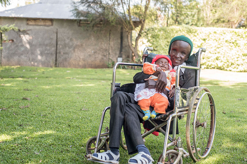 Gibson has spina bifida and hydrocephalus. He can't walk and has very limited limb function and yet he still helps take care of his baby brother. This one time he had come for follow-up clinic, which sometimes has long queues, and so he was helping his mother hold his sleeping brother.