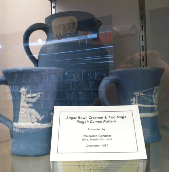 Sugar Bowl, Creamer and Two Mugs in blue with slip cameo scenes of fiddler and spinning wheel - by Pisgah Forest Pottery