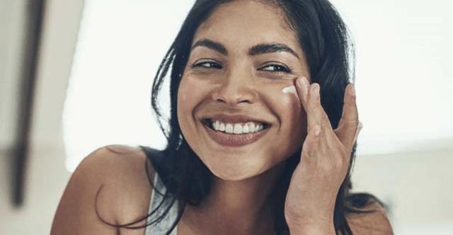 applying moisturizer on face