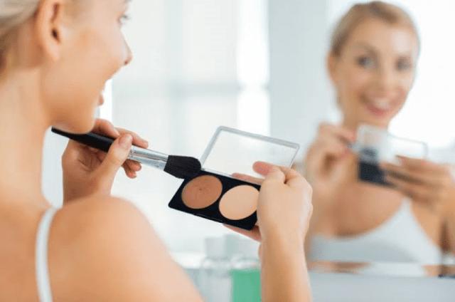 female picking makeup