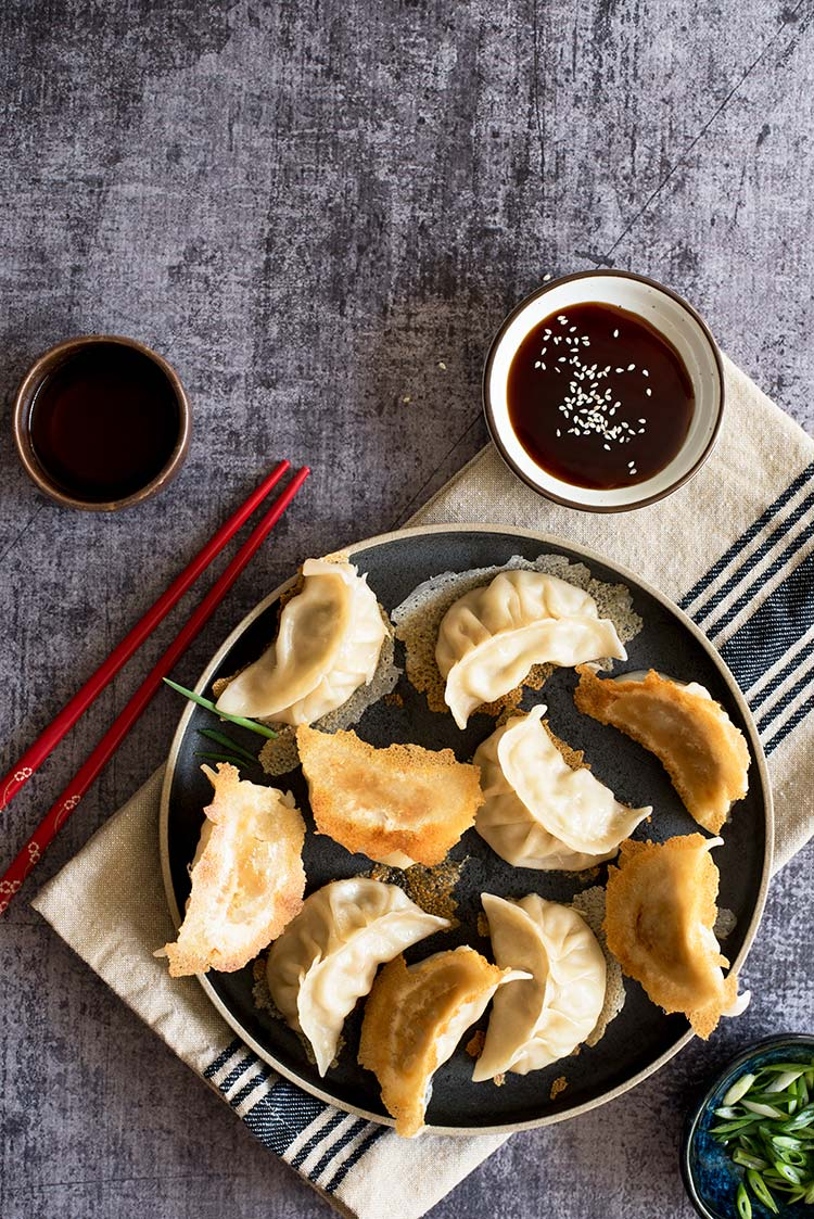 Part thin & crispy, part soft & tender with a delicious pork filling inside. The textural difference of the potstickers will blow your mind.