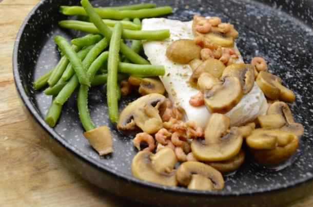 Recept Schelvis met wittewijn saus en champignons