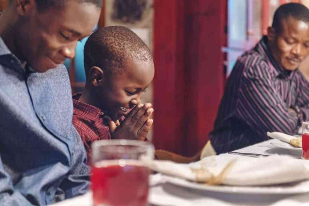 Boy Learning to Pray
