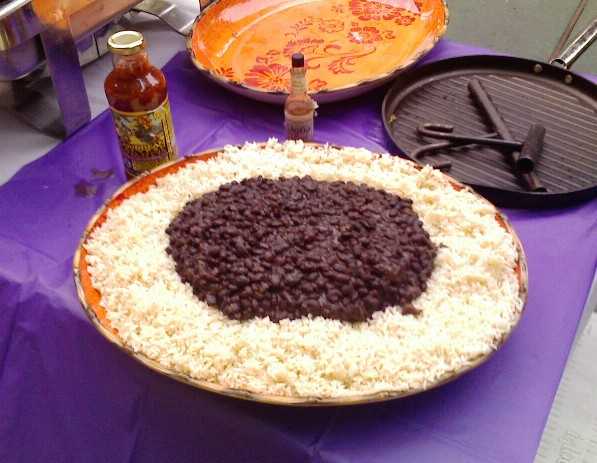 A plate of moros y cristianos, showing that the rice was not cooked in the same pot as the beans.