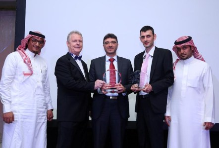 Eng. Safwan Al Khatib, Managing Director of Smart Link (center) along with his team receiving the award from INSIGHTS' President Dominick Keenaghan