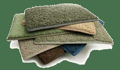 stack of green carpeting