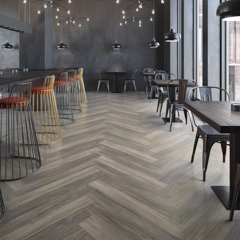 The classic herringbone adds a rustic appeal to this modernized cafe with Mannington Flooring.