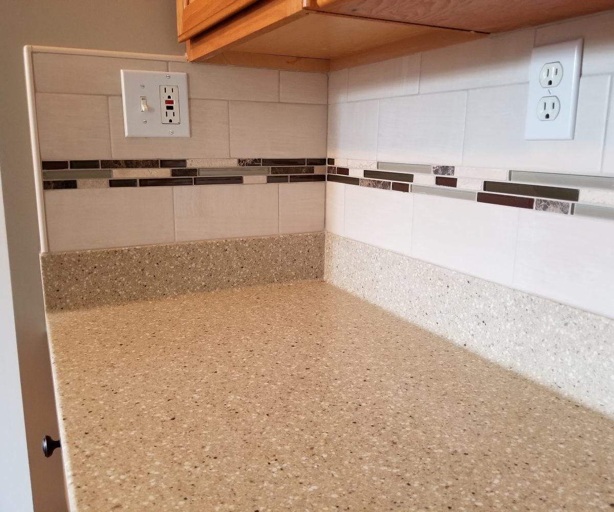 Daltile Skybridge Off White subway tiles with Bliss Cabernet mosaic accent.