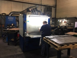 Machine Finishing Work at Custom Laser Inc.