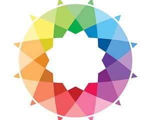 A rainbow colored sunburst, the logo for Custom Pilates and Yoga