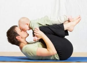 Mom does yoga or Pilates with baby
