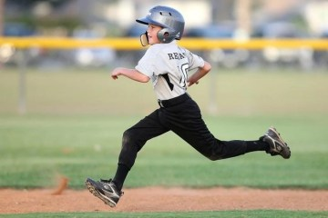kid running the bases, full of pride
