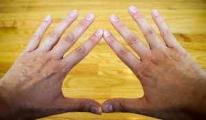 hands in a triangle