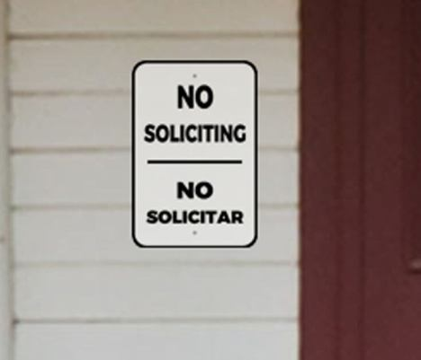 Bilingual No Soliciting Sign Near Front Door