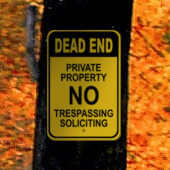 Dead End Private Property No Trespassing or Soliciting Sign on Tree