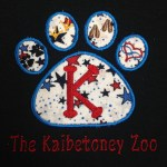 black shirt with Kaibetoney Zoo logo left chest