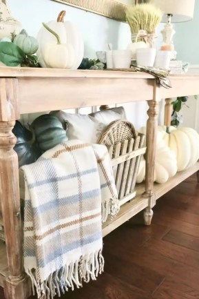 A cozy blanket invites guests to grab a cup of coffee and linger.
