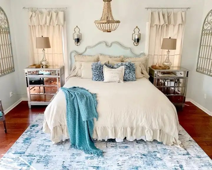 cottage style bedroom with drop cloth curtains