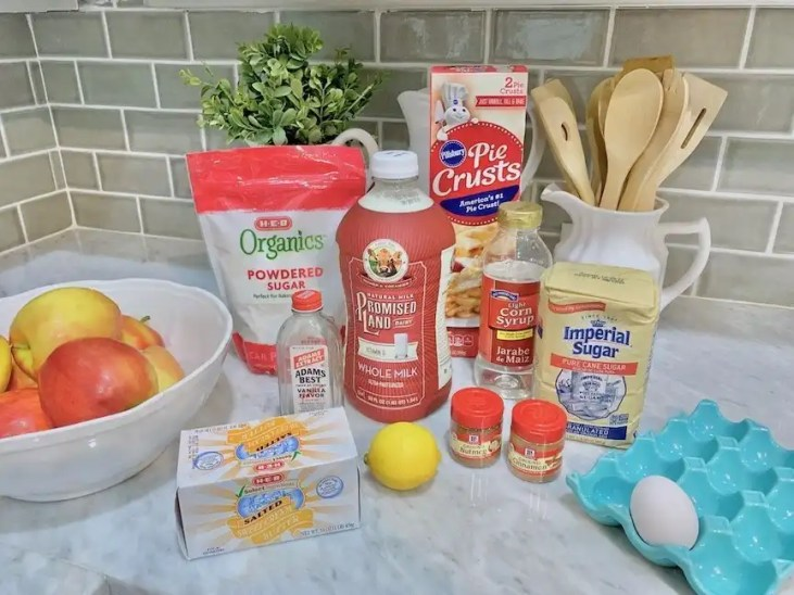 Basic baking ingredients, fresh apples and already made pie crust for apple turnover recipe