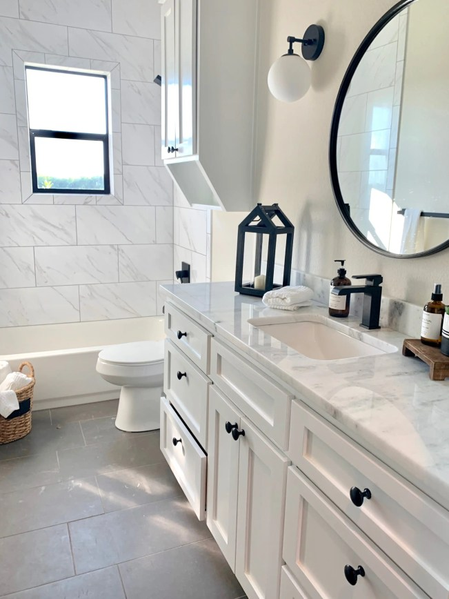 When home staging the bathroom, give it a spa like feel with rolled plush towels.