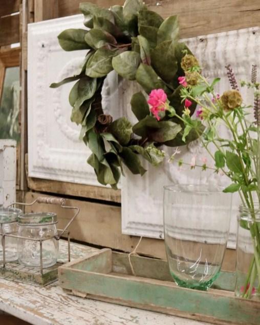 Ceiling tiles add a fun texture behind a wreath.