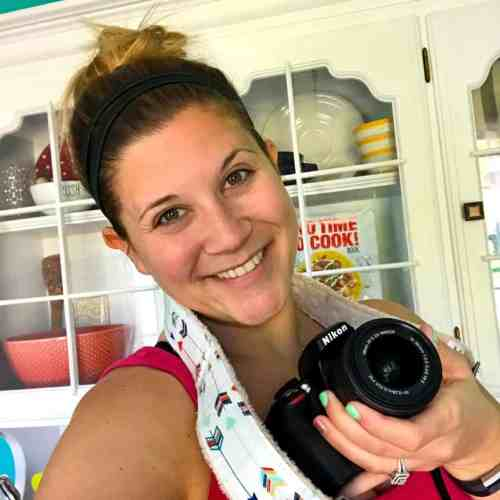 Photo of Caitlin holding Nikon camera