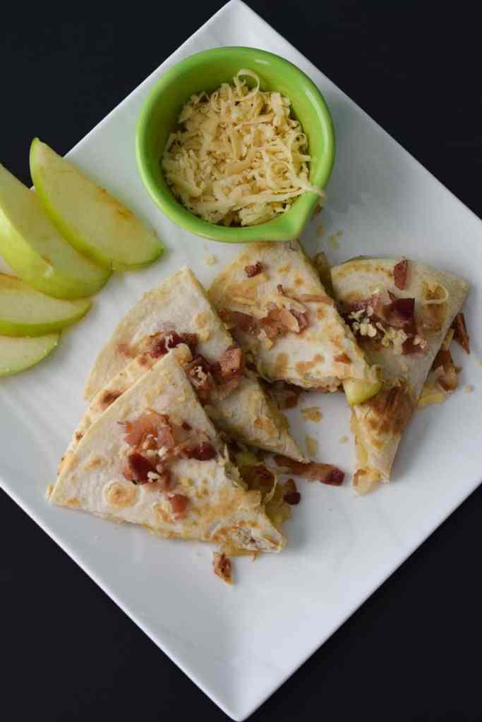 Overhead photo of Gouda Bacon Onion Apple Quesadillas on white plate