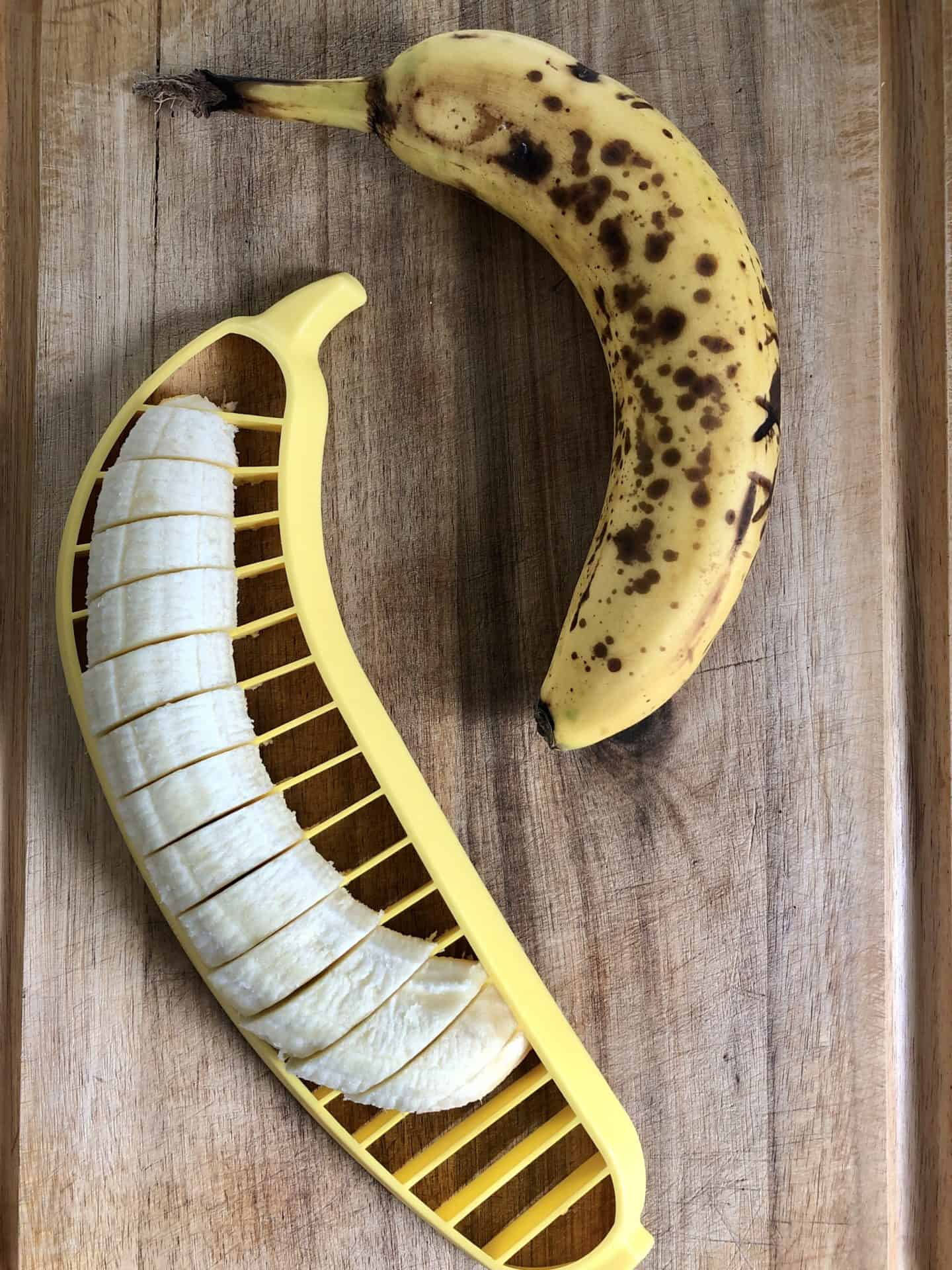 Bananas being sliced with a banana slicer