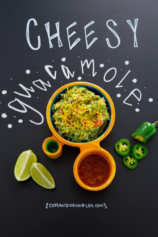 Cheesy Guacamole with title written on chalkboard