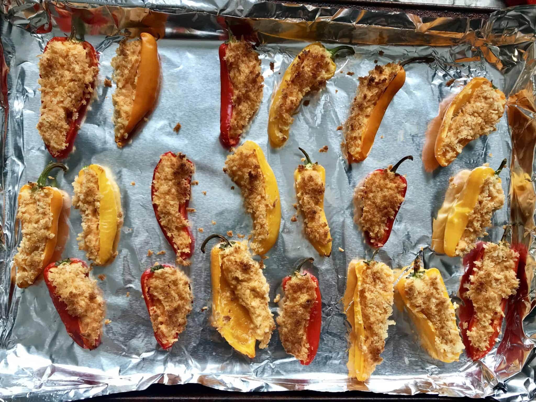 Mini peppers topped with bread crumbs baked overhead shot