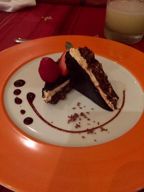 Chocolate cake on orange plate close up view