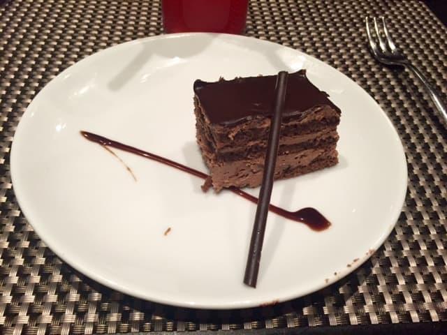 Layered chocolate cake on white plate