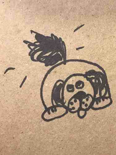 drawing of a dog wagging his tail drawn with sharpie on brown paper